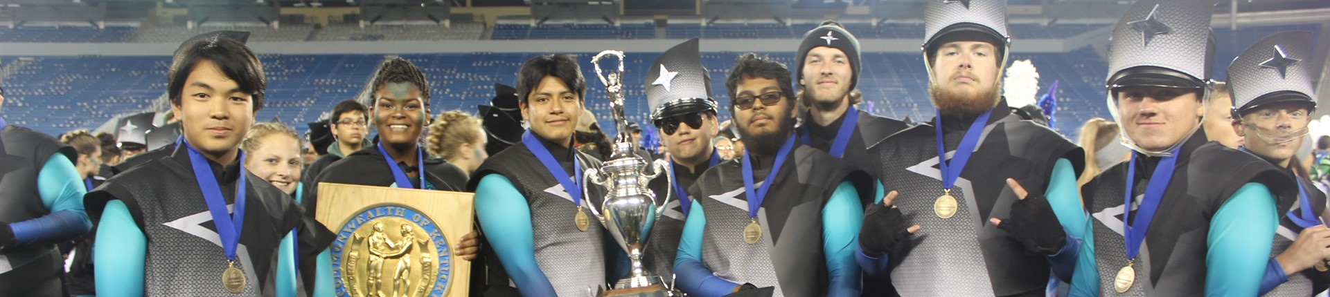 Senior Band Members With State Champion Trophy